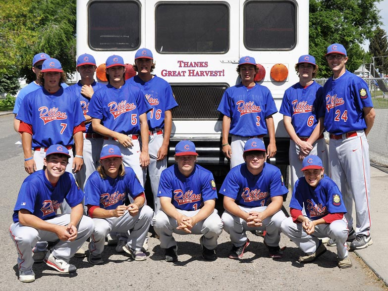 "photo of the Dillon Cubs American Legion Baseball team in front of their team bus which reads ""thanks, Great Harvest"""
